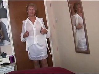 Nasty granny in witness thru top and slip teasing and flashing