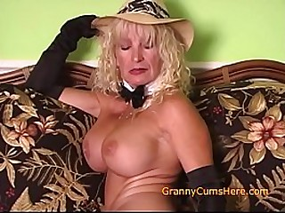 Hot Granny fucks herself