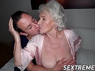 Facialized granny spreads legs for cock