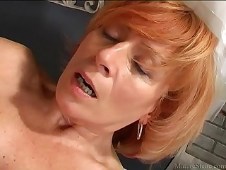 Attractive granny pleasing her cunt with a new sex toy