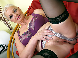 Busty granny undressing and toying with her tits and pussy