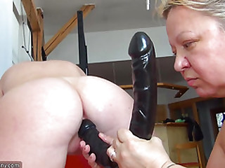 OldNanny Old chubby lady is wanking young skinny girl with big dildo