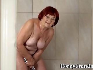 Showering granny redhead rails and sucks