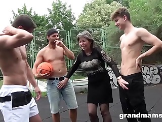 Horny Granny Fucks Basketball Twinks in Public