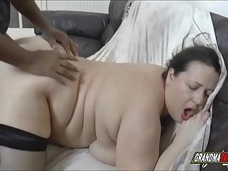 busty grandma takes a big black cock