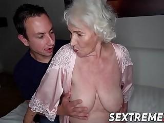Busty elder Norma sucks cock before foray