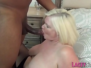 Busty grandma blows rod